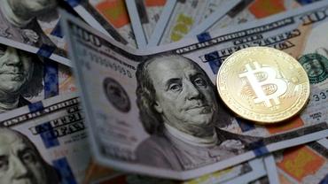 Un ieșean, reținut după ce a furat criptomonede în valoare de 620.000 dolari de la o companie din insulele Cayman