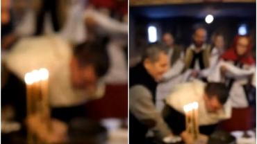 Imagini de la botezul din Suceava. Bebelușul, scufundat în cristelniță cu fața în sus, deși preotul trebuia să-l țină invers. Video