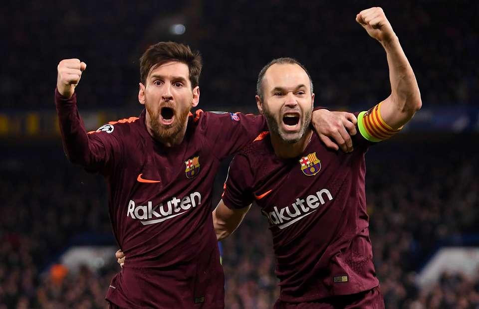 Lionel Messi şi Andres Iniesta