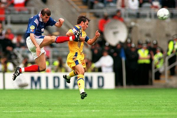 10-JUN-96 ... France v Romania ...  France's Zinedine Zidane takes the ball from Romania's Gheorghe Hagi